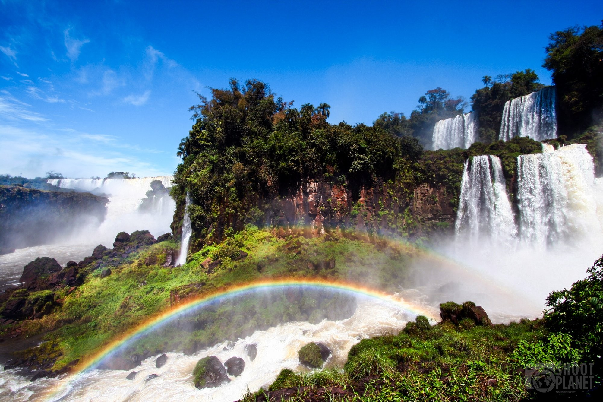 Iguazu Falls cataracts and double rainbow