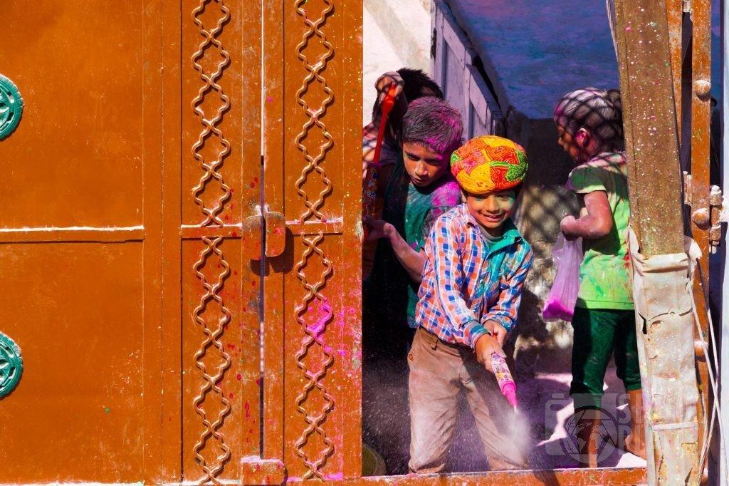Children playing during Holi celebrations, Mathura India