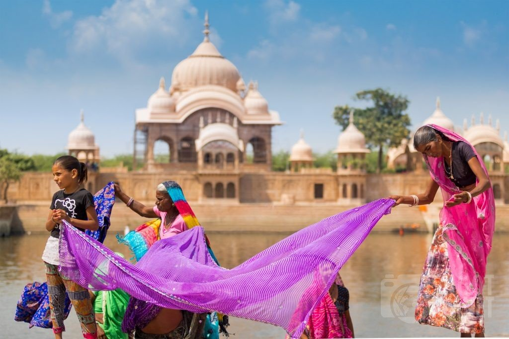 Colorful family at Kusum Sarovar, Mathura India