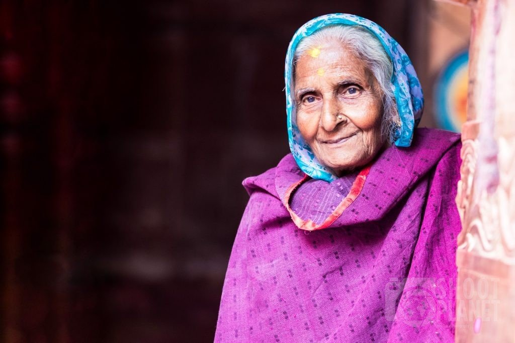 Old woman smiling portrait, Vrindavan temple, India