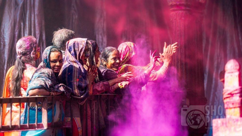 Women celebrating Holi, Vrindavan temple in India