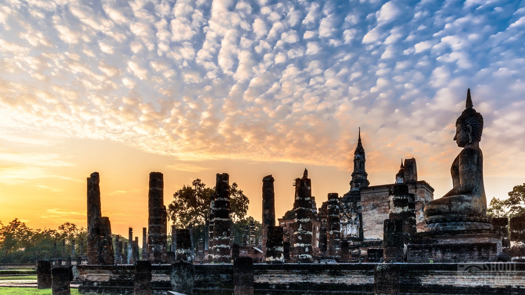 Wat Maha temple colorful sunrise, Sukhothai Thailand