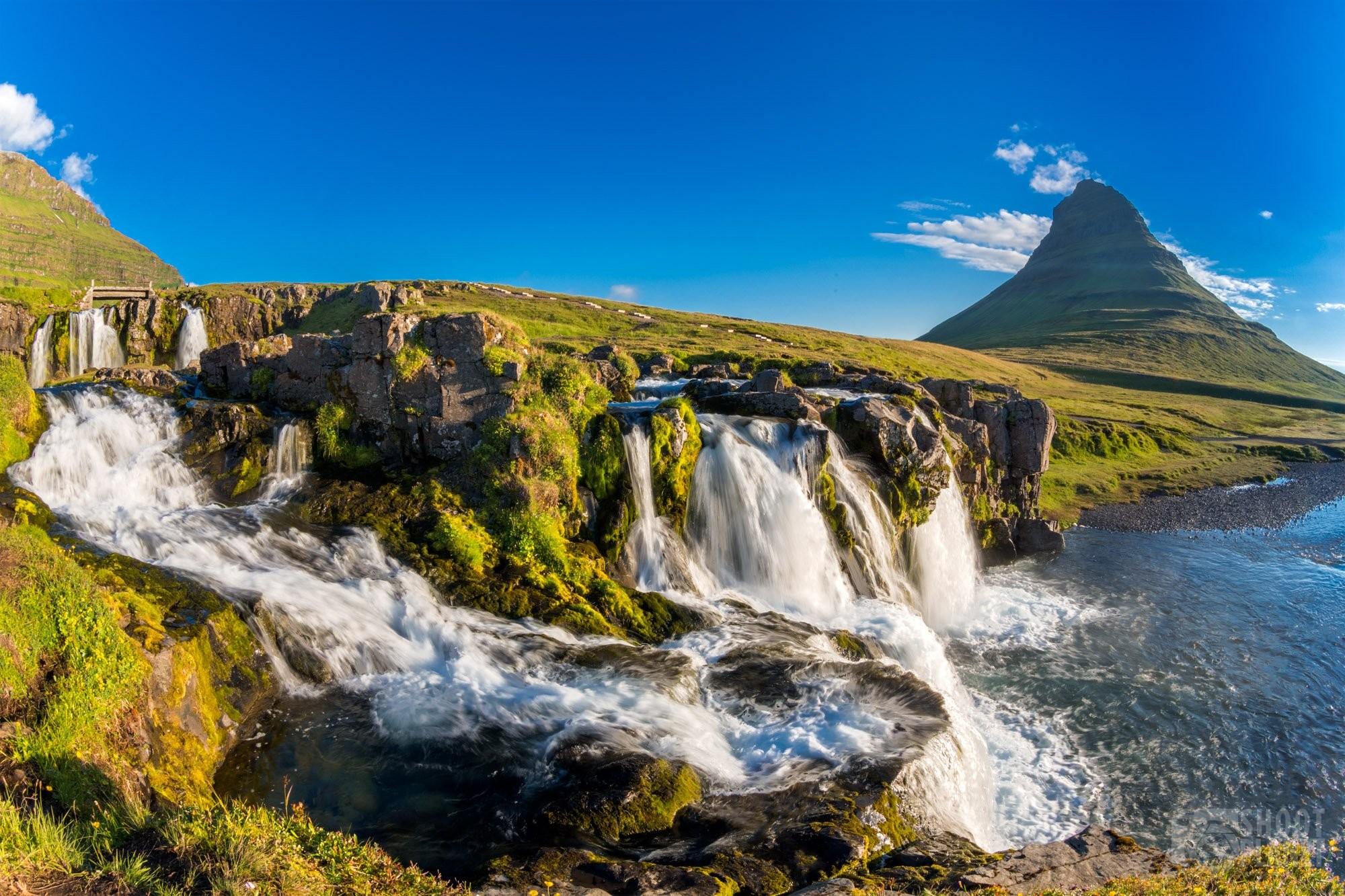 Kirkjufellsfoss falls and Kirkjufell mountain in Iceland