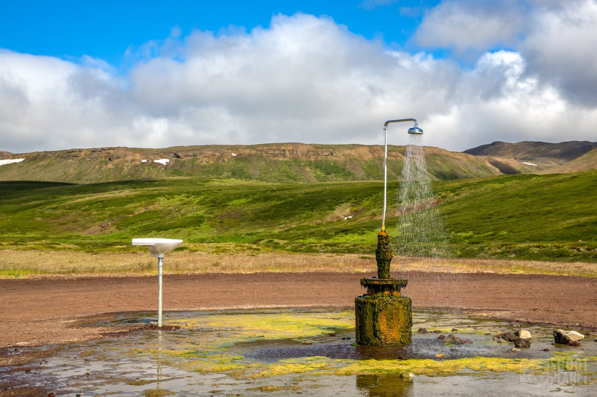 Outdoor geothermally-heated shower in Iceland