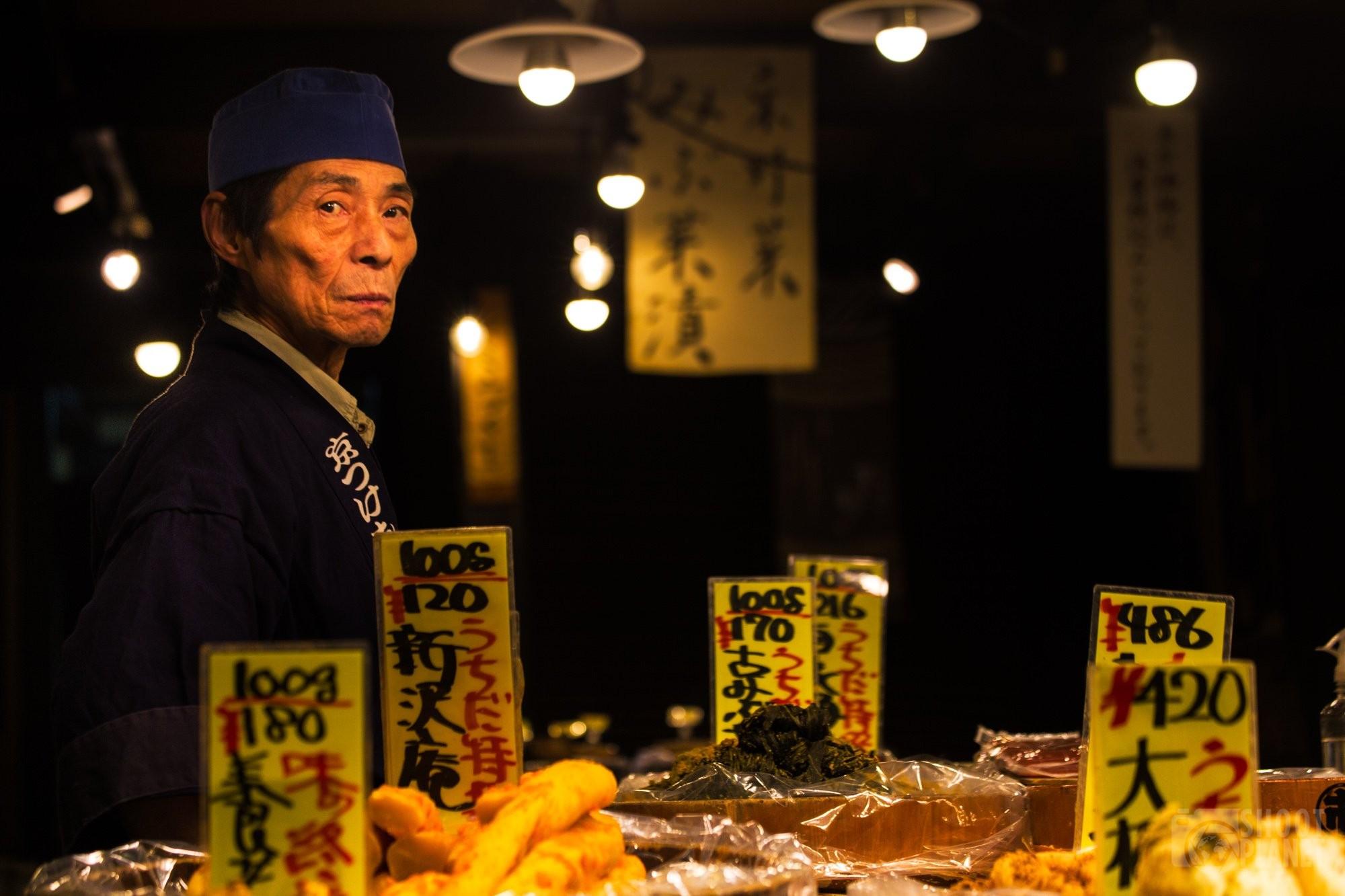 Japanese shop salesman in Nishiki Market, Kyoto