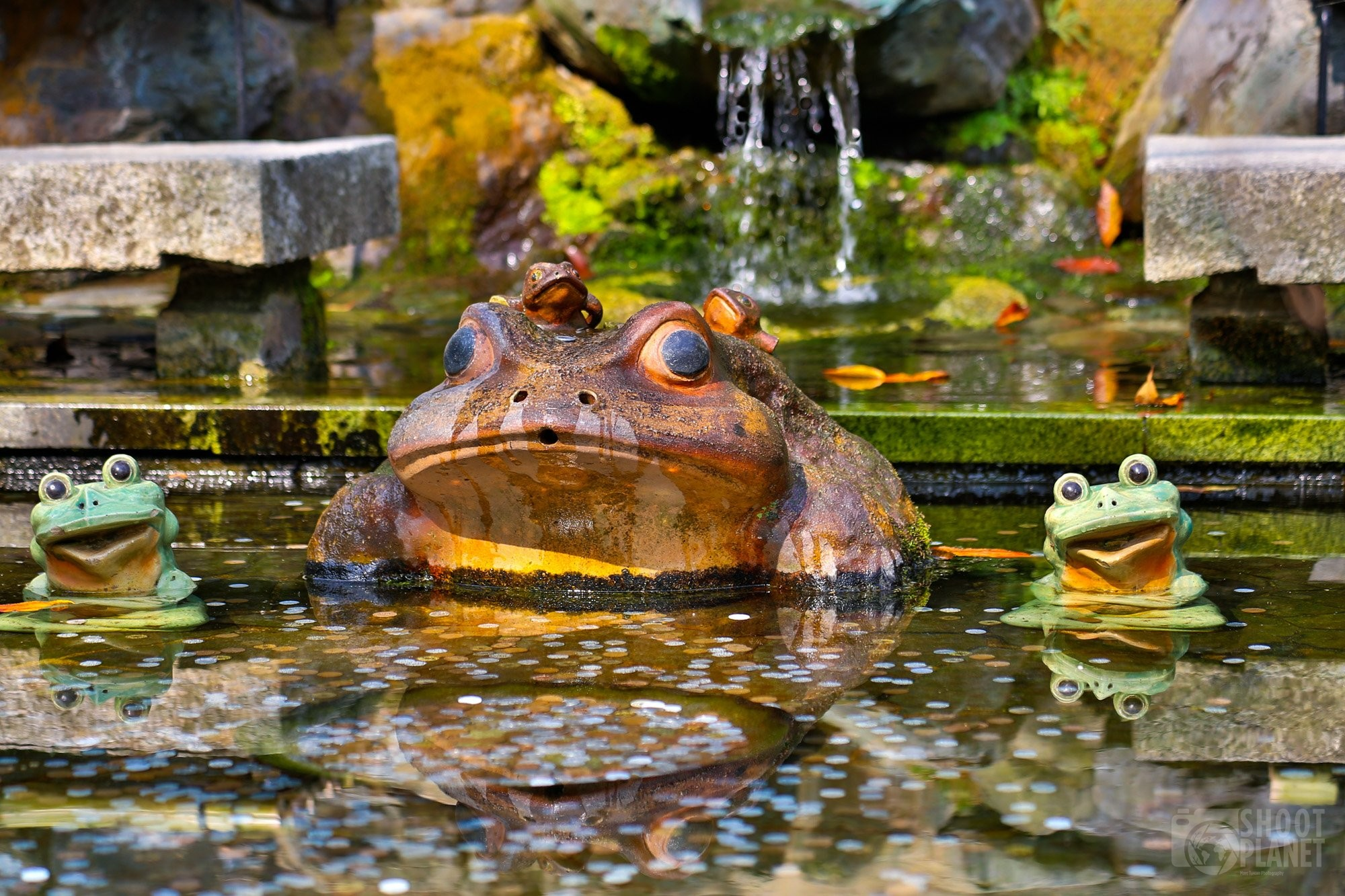 Frog statues luck fountain Kyoto