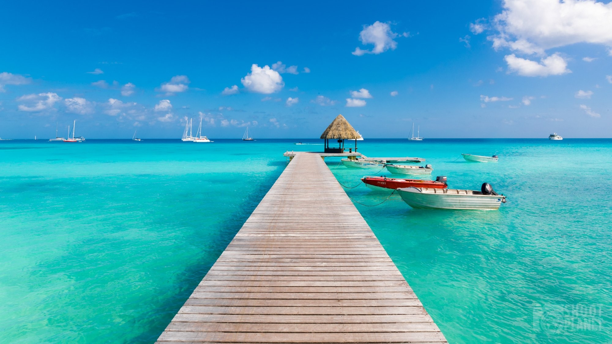 Wooden pier and boats in Rangiroa Polynesia