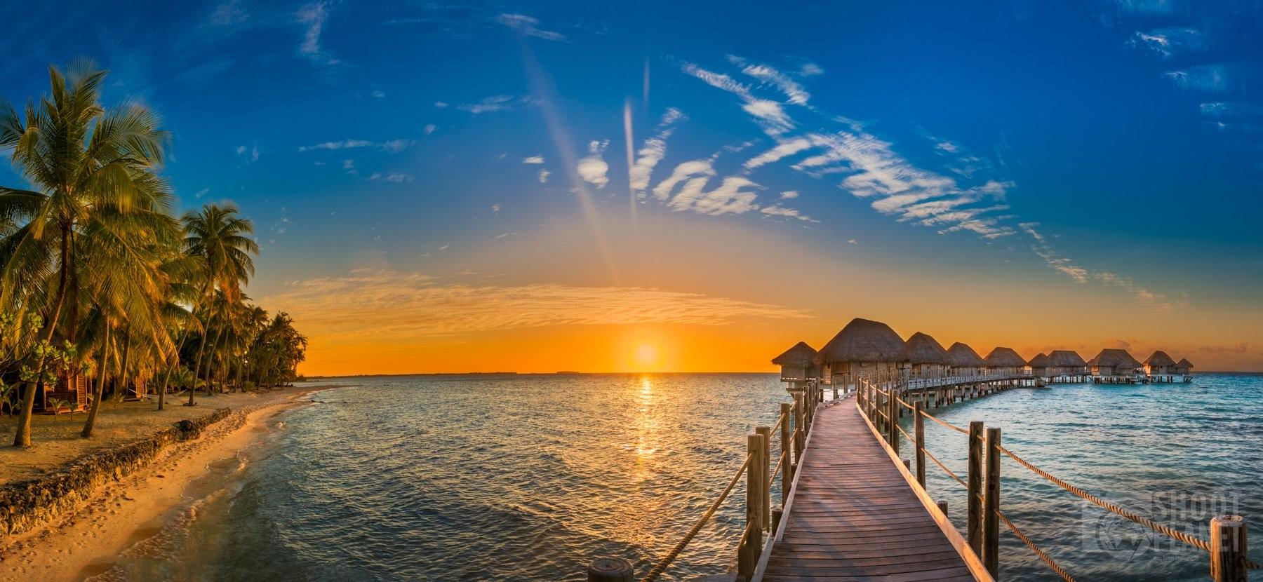 beach and overwater bungalows sunset, Tikehau Polynesia