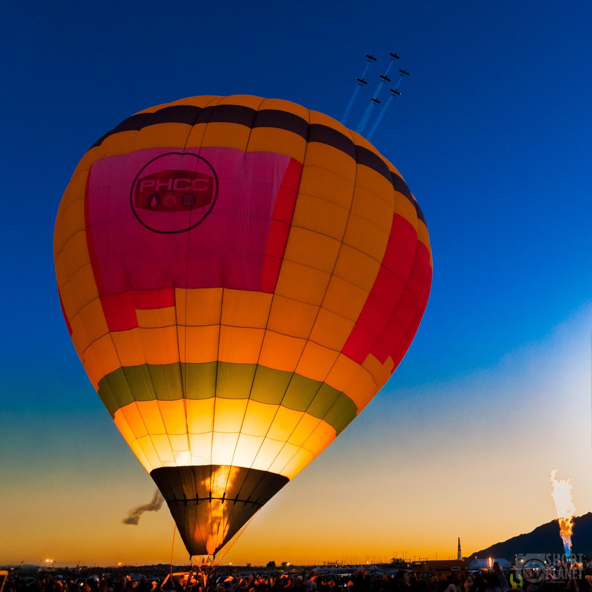 Balloon and acrobatic planes twilight, Albuquerque USA