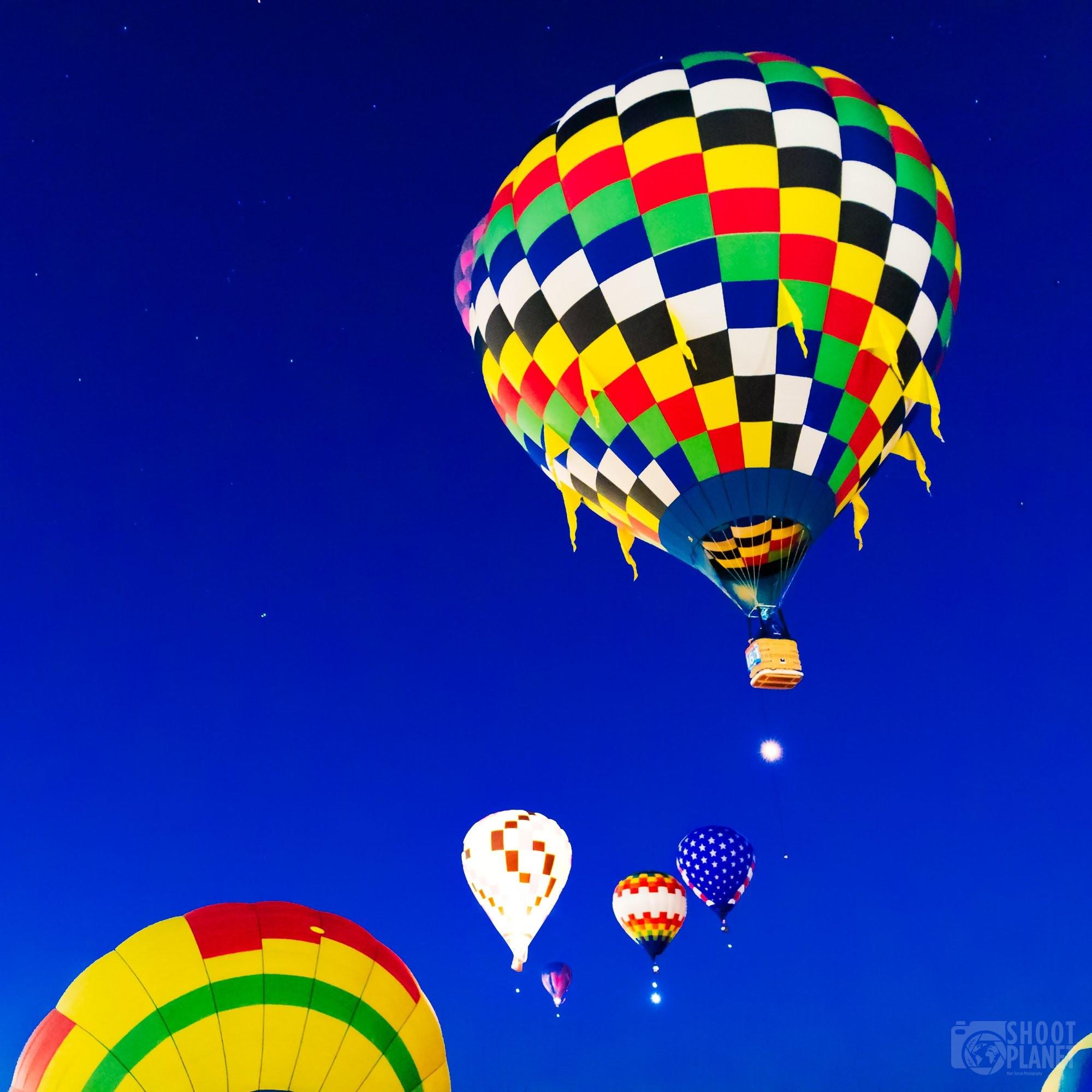 Colorful balloons in starry sky, Albuquerque USA
