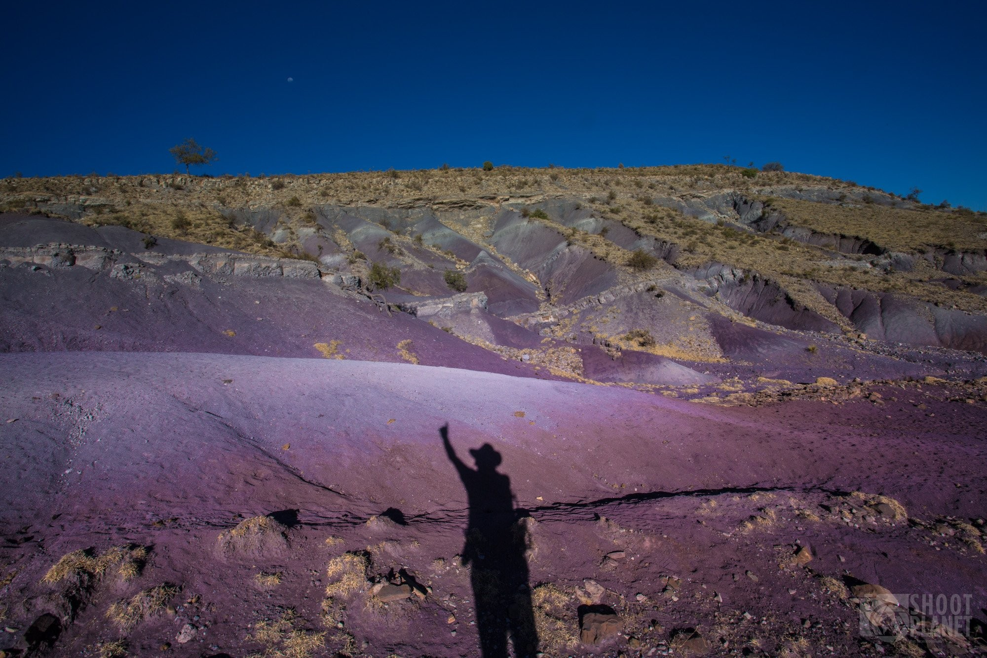 Marangua crater purple rocks shadows