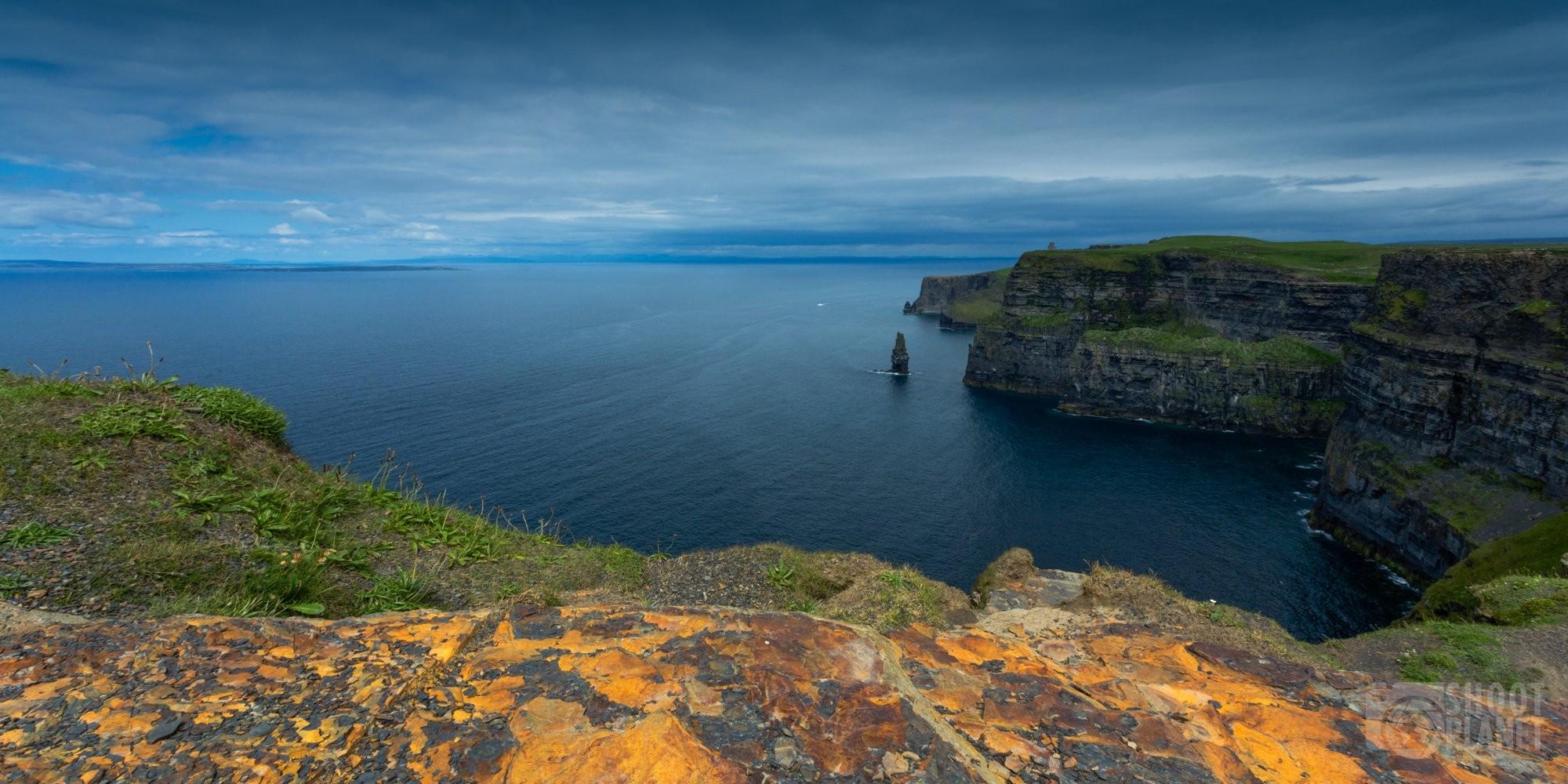 Cliffs of Moher cloudy sky landscape, Ireland