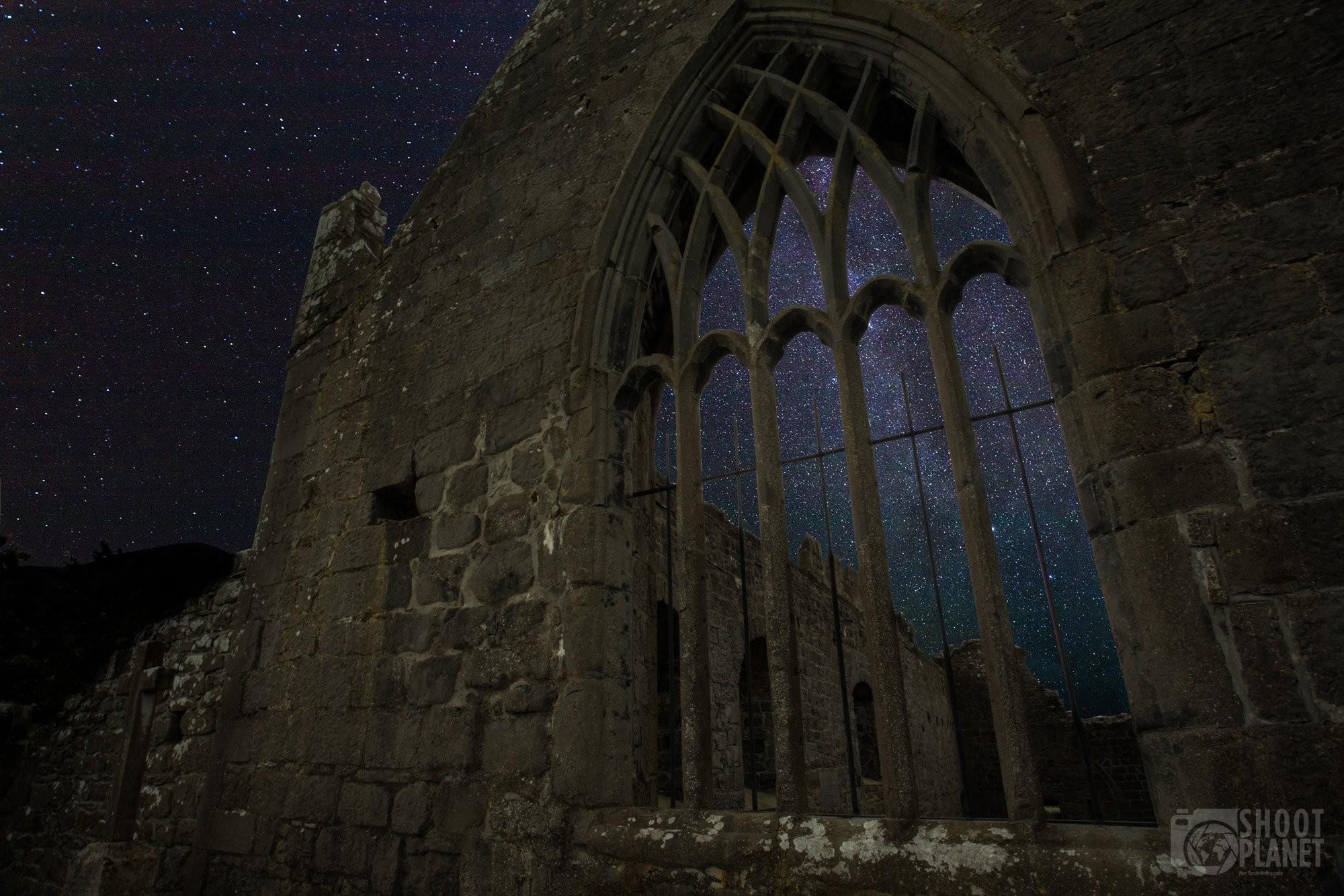 Murrisk Abbey ruins under starry sky, Ireland