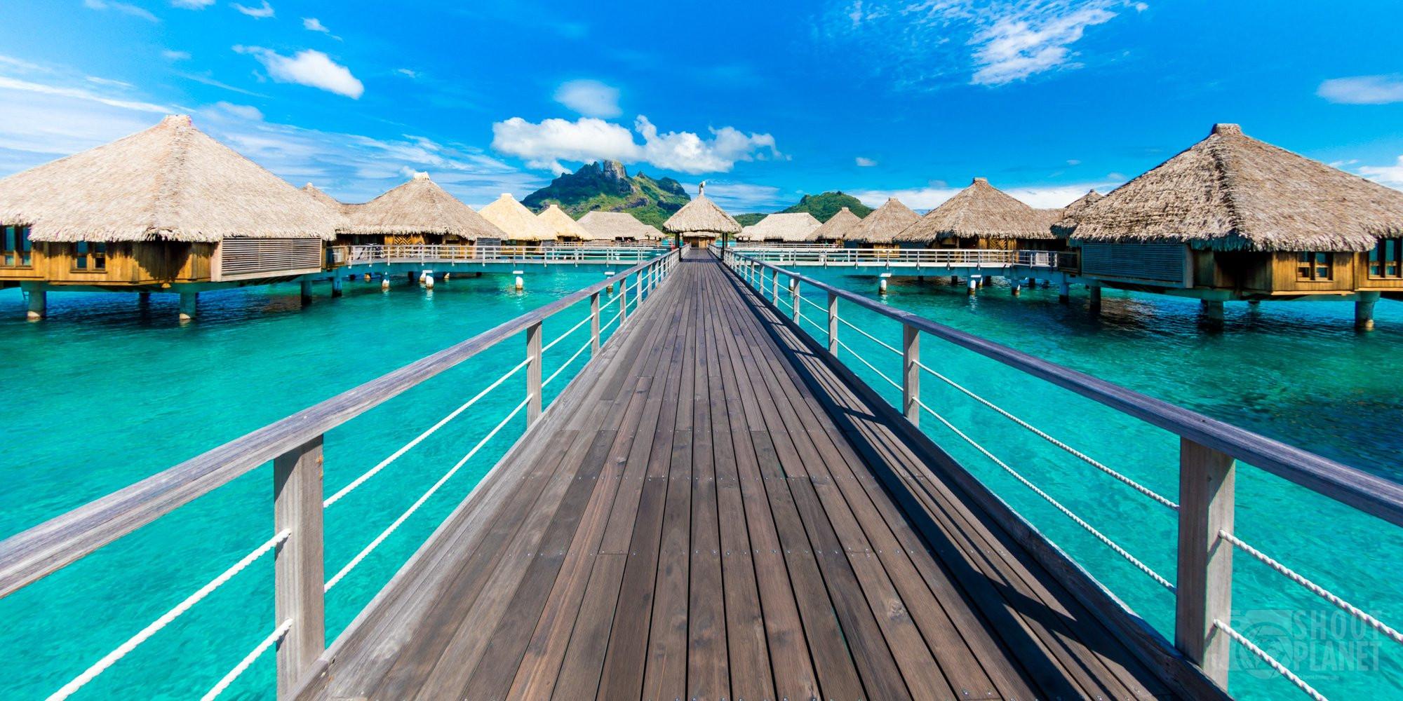 Overwater bungalows wooden bridge, Bora Bora, Polynesia