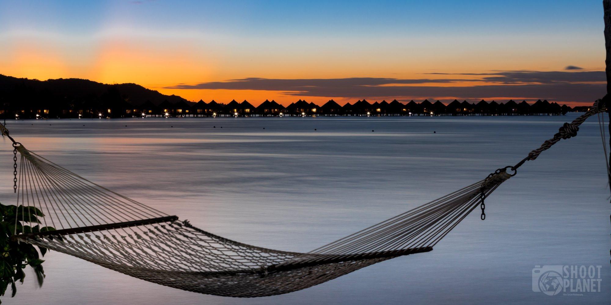 Hammock and overwater bungalows Bora Bora sunset