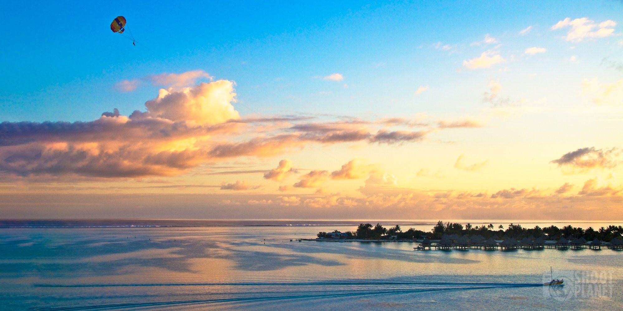 Sunset parasailing above Bora-Bora lagoon