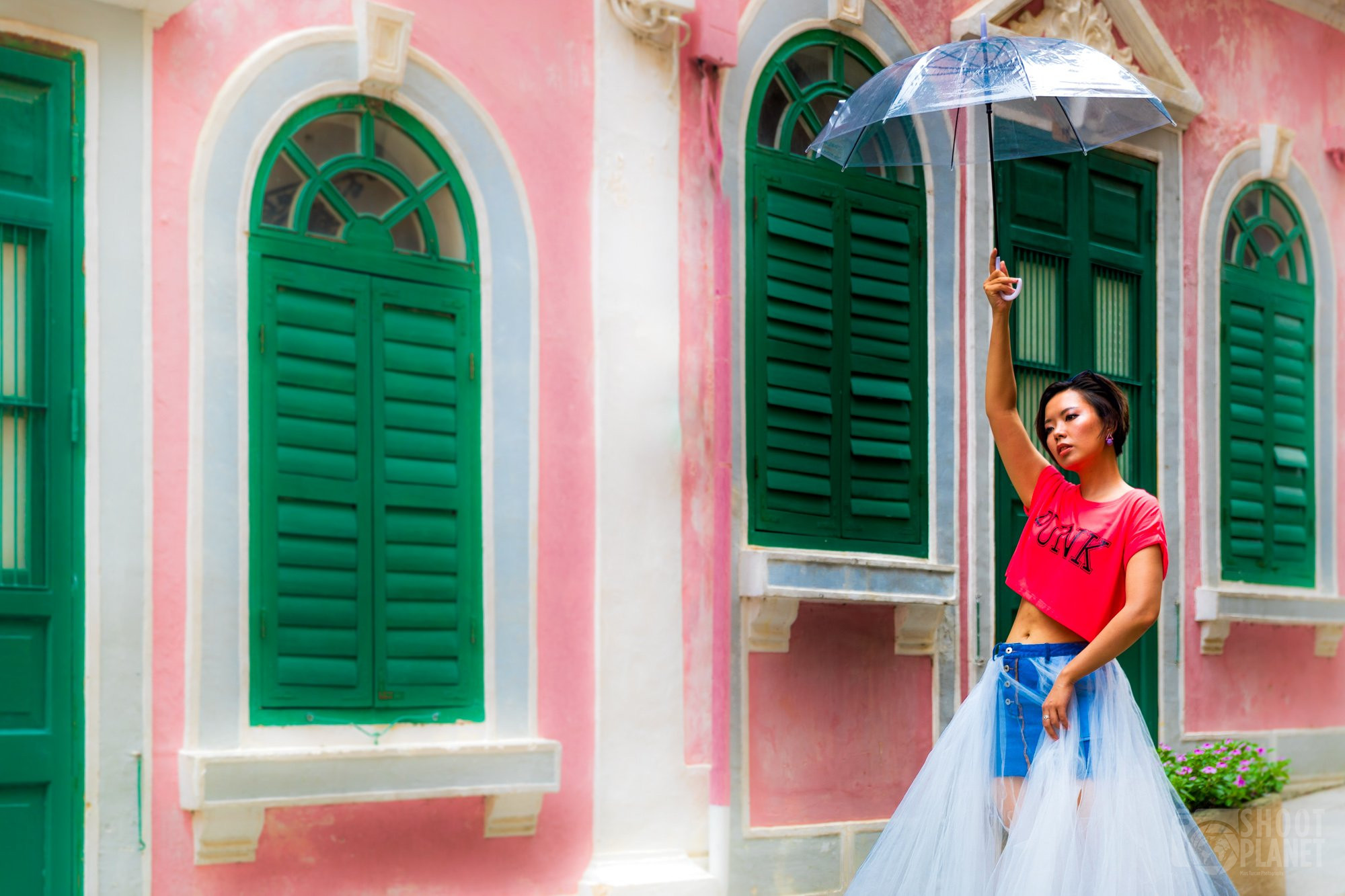 Woman posing Travessa da Paixao, Macao China