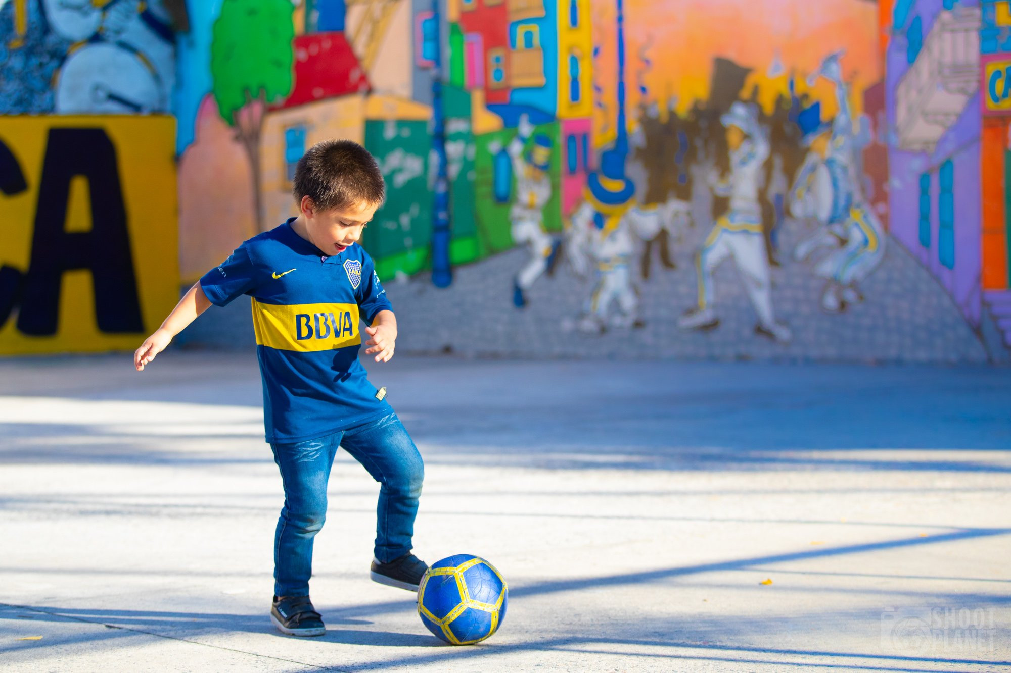 Kid playing football, Buenos Aires Argentina