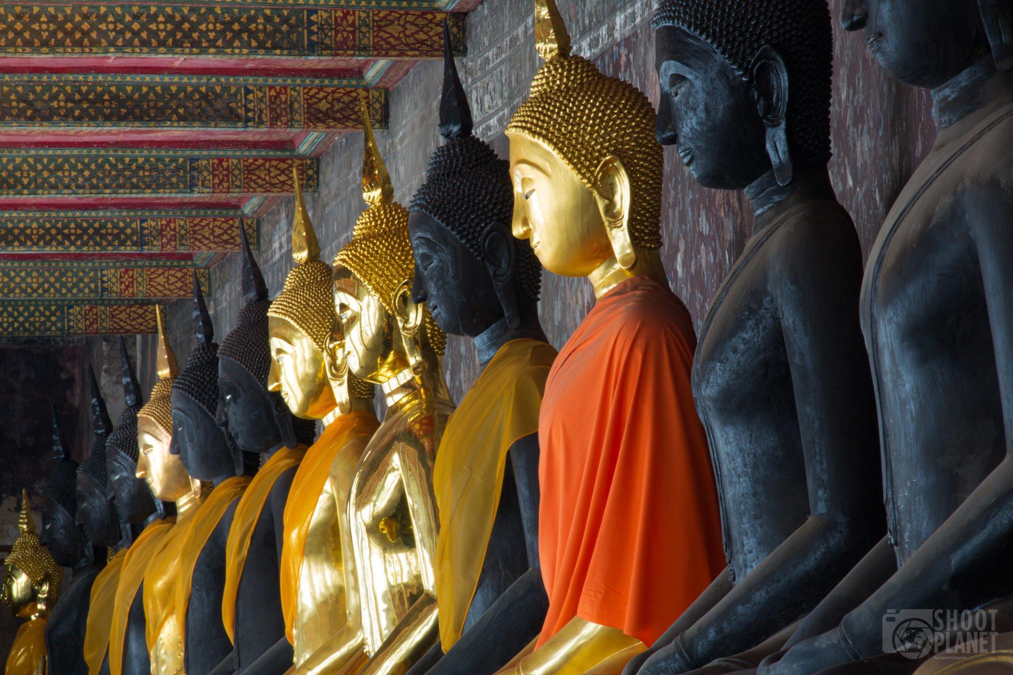Colorful, robed Buddhas, Wat Pho, Bangkok Thailand