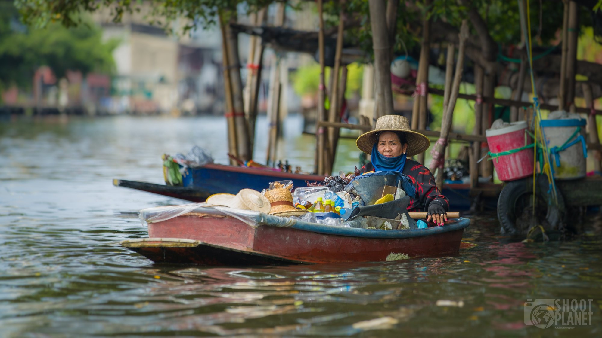 Woman selling on a boat , Bangkok canals, Thailand