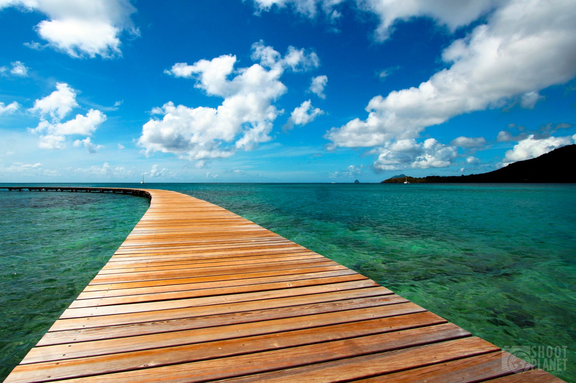 Curved wooden pier, Martinique Caribbean Island