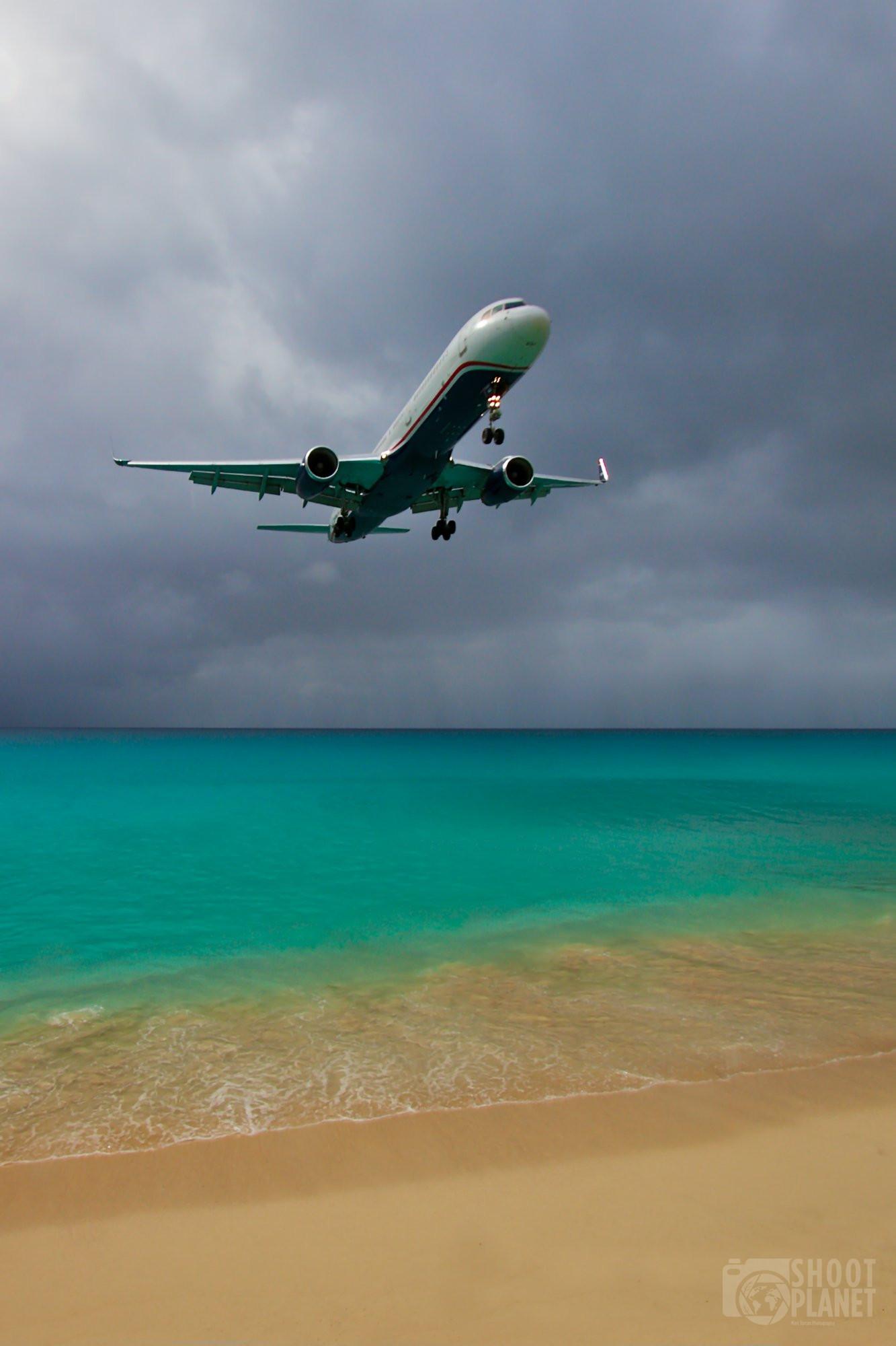 Plane landing in Sint Marteen Caribbean island