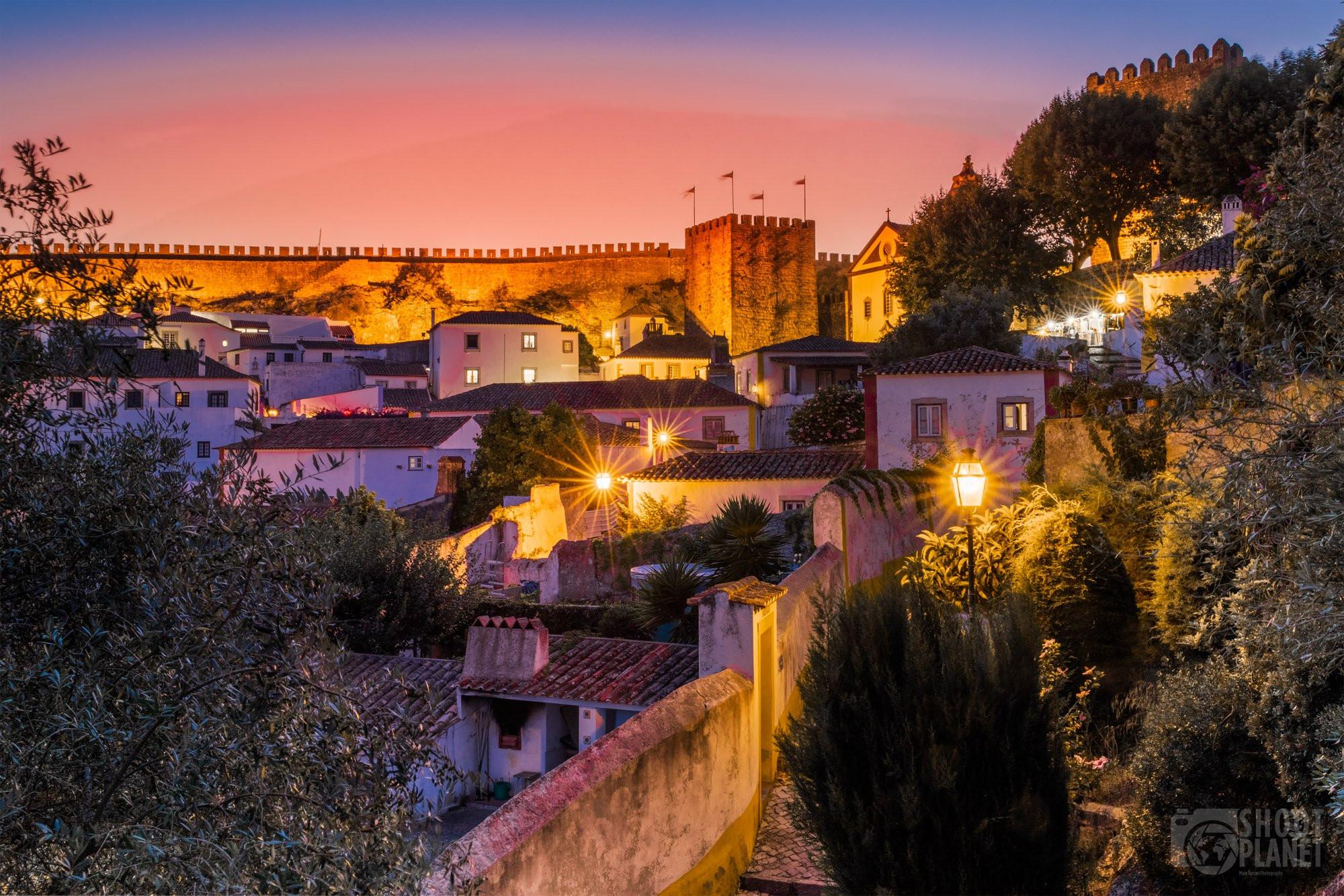 Lit-up city Obidos village sunset, Portugal