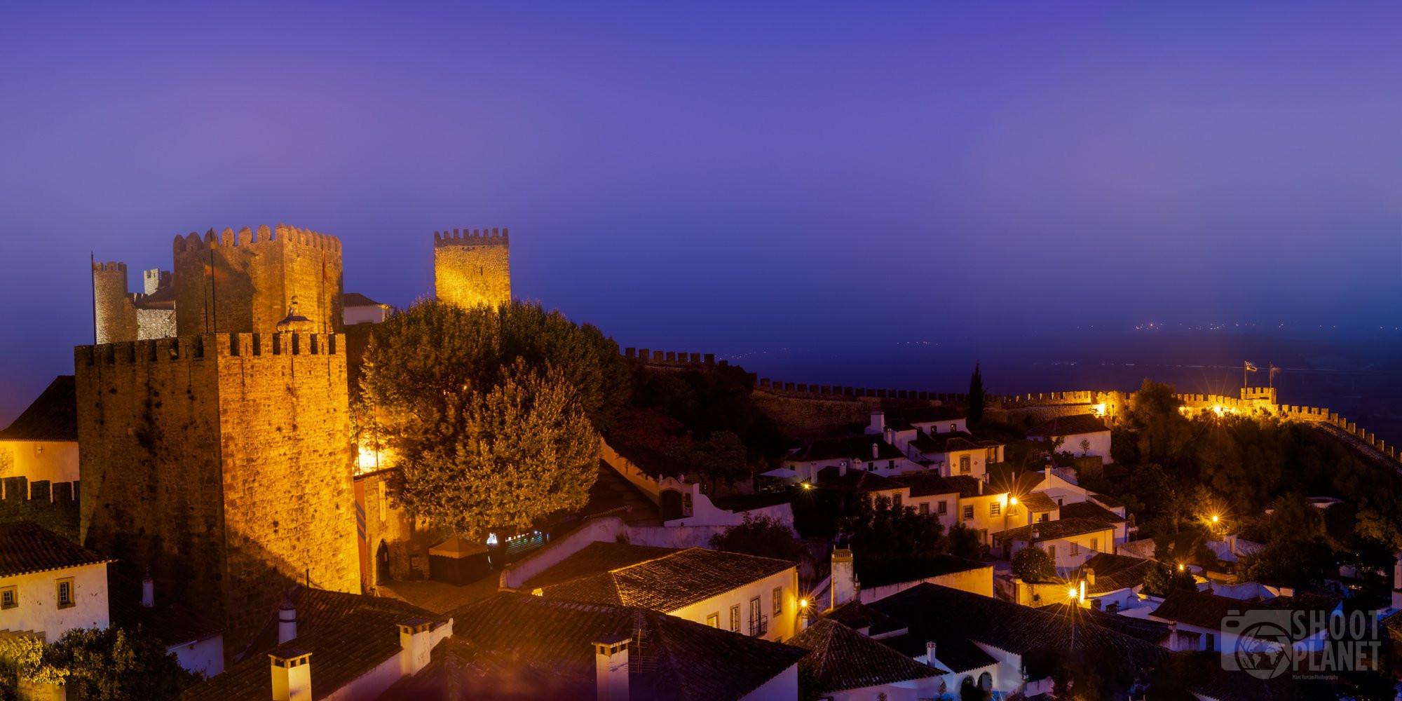Lit-up city wall twilight, Obidos, Portugal
