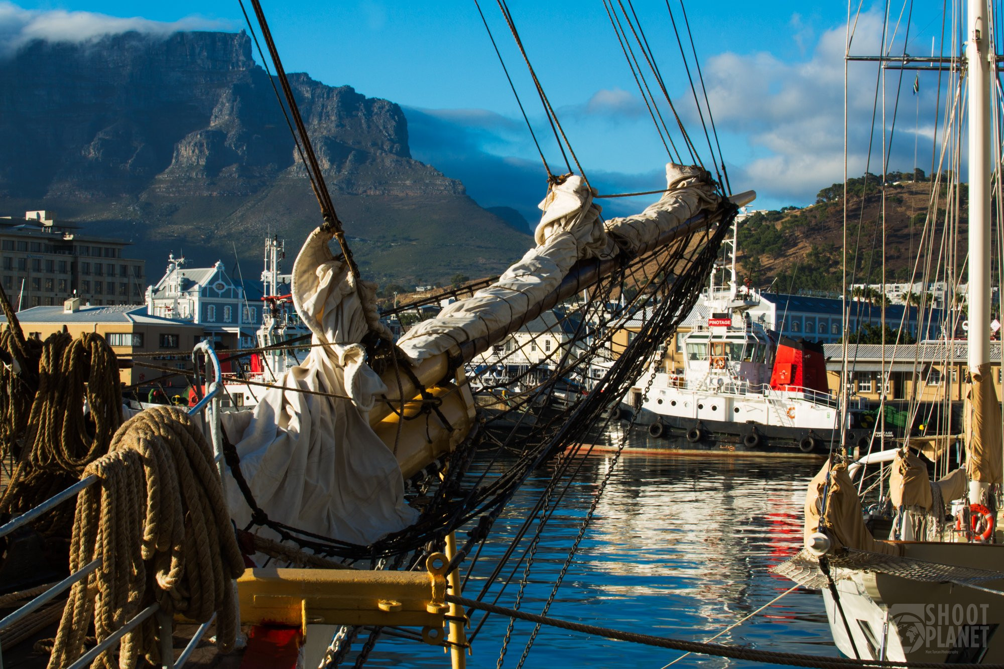 Cape Town harbor bowsprit and Table Mountain