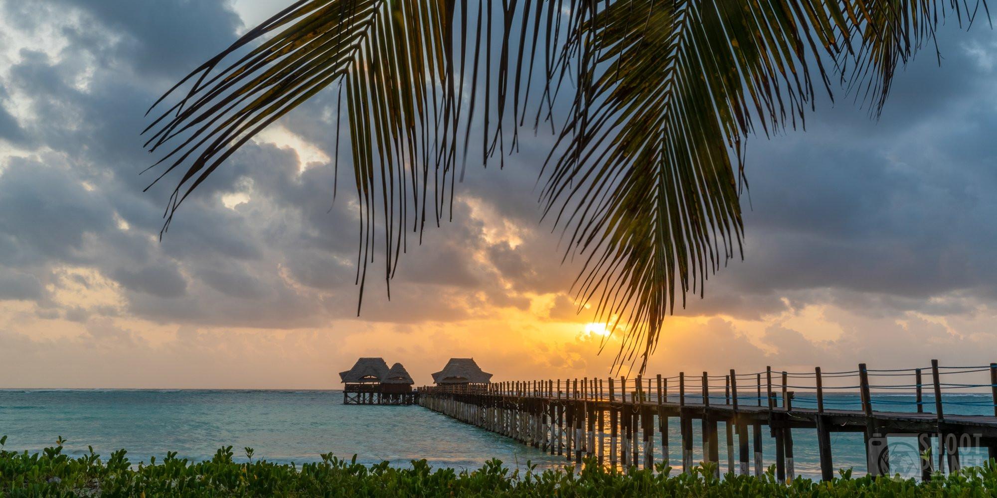 Dongwe beach and Pier sunrise Zanzibar Tanzania