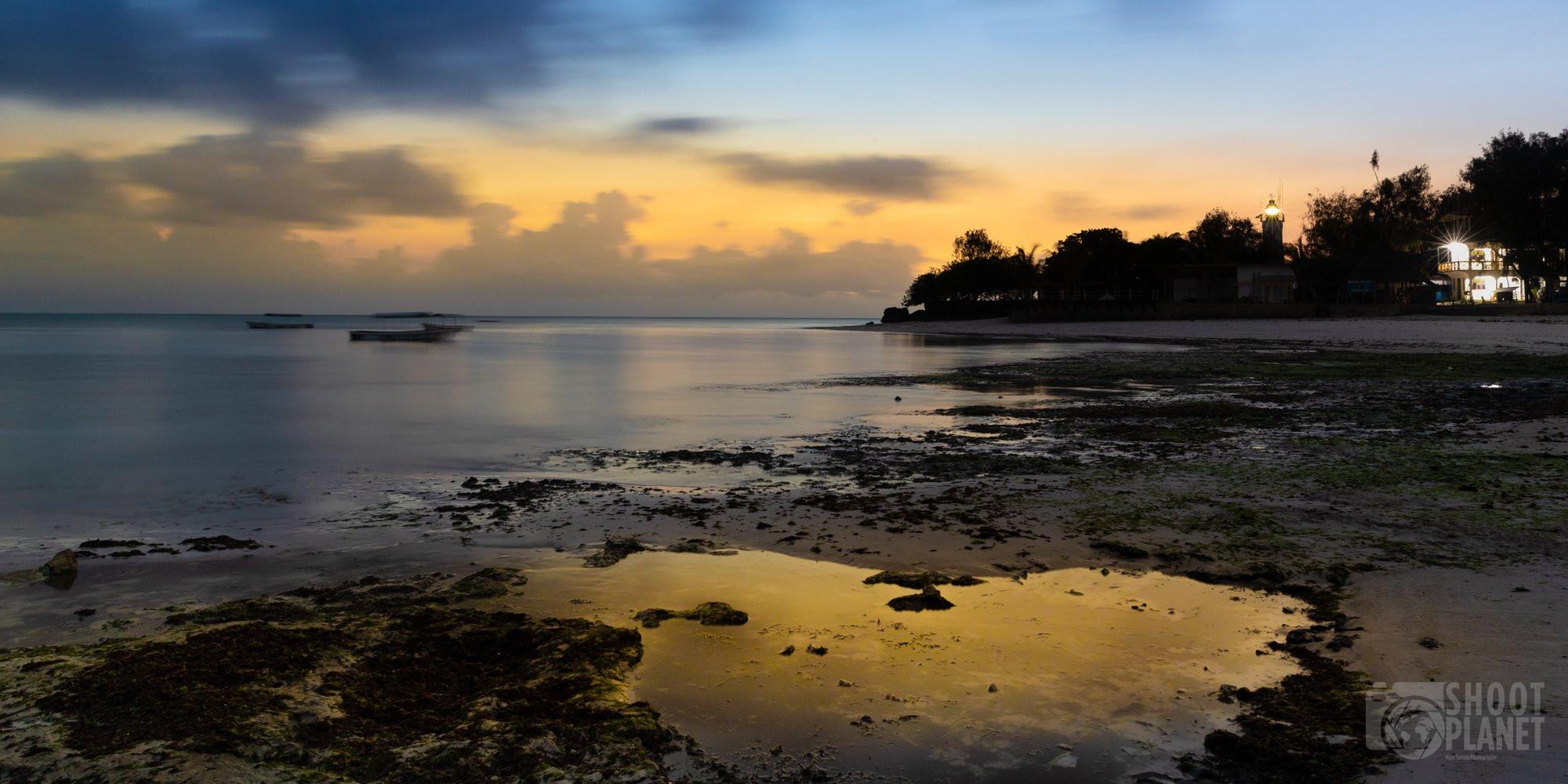 Nungwi beach sunrise reflections, Zanzibar Tanzania