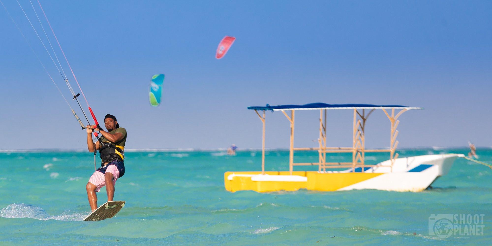 Kite surfers and boats Paje beach, Zanzibar Tanzania