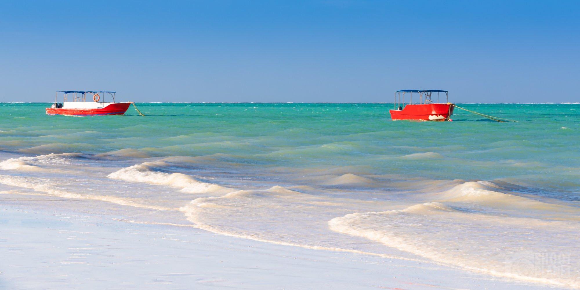 Boats on pristine Paje beach, Zanzibar Tanzania